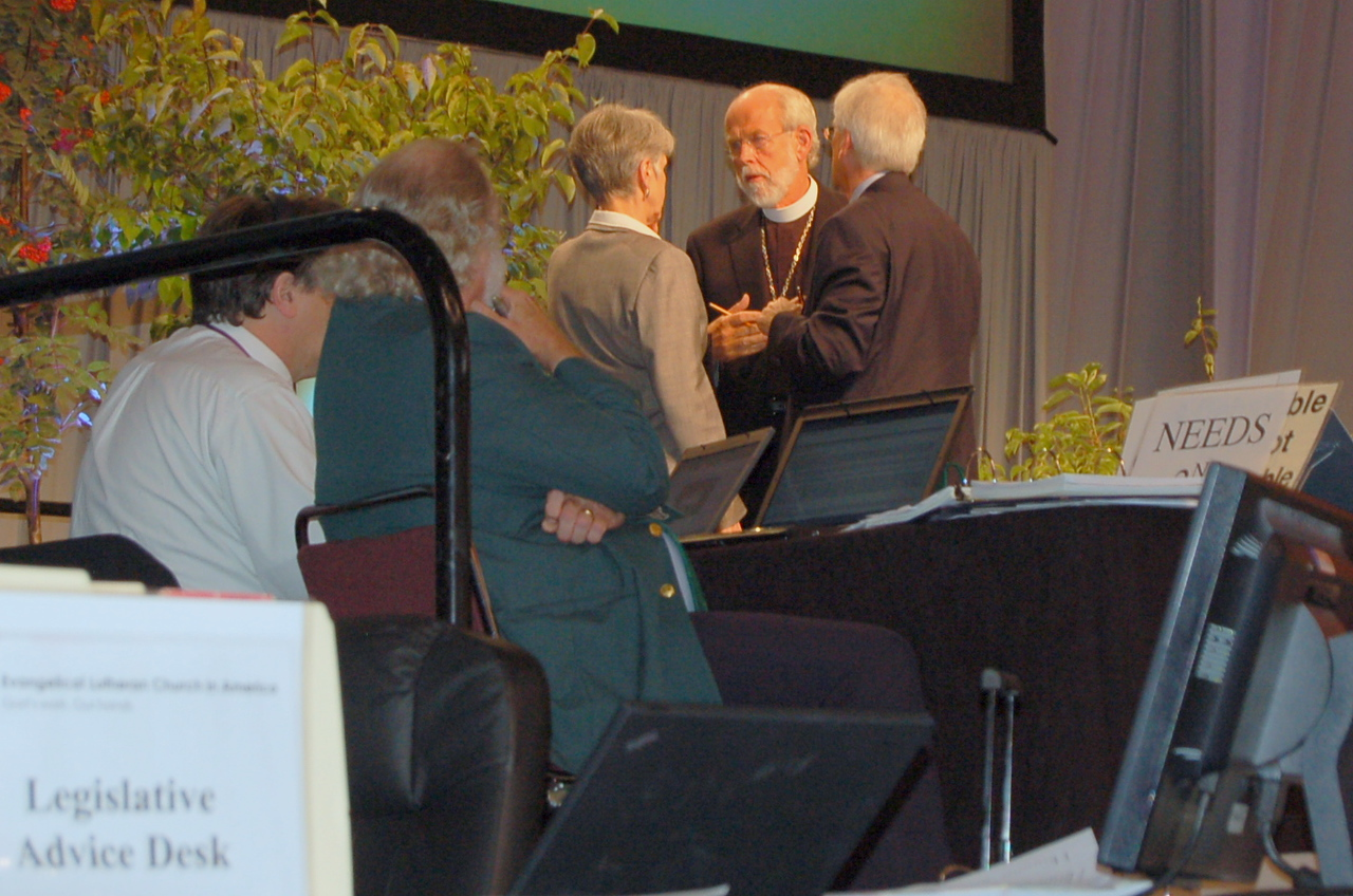 The Rev. Mark Hanson, presiding bishop, consults with Myrna Sheie, executive for governance and institutional relations, and David Swartling, secretary, on the remaining time for plenary session three.