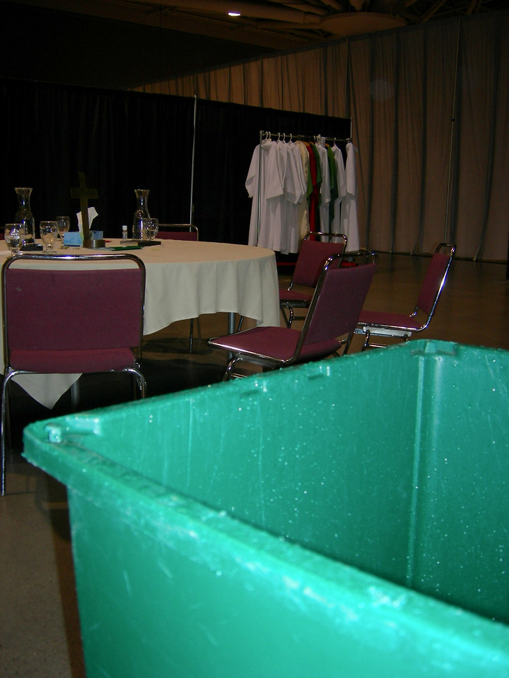 A bucket is used to collect water in the Sacristy.