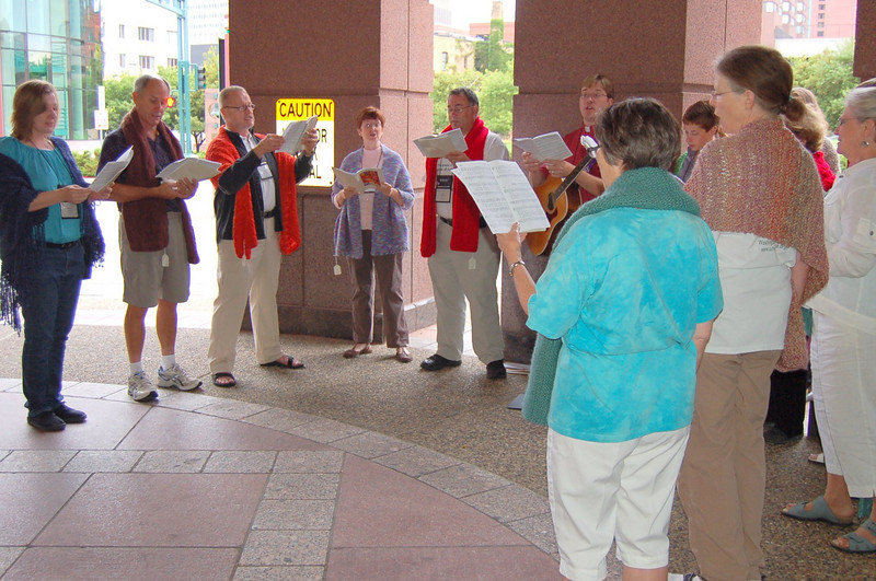 Impromptu choir from Good Soil sings hymns outside the Minneapolis Convention Center.