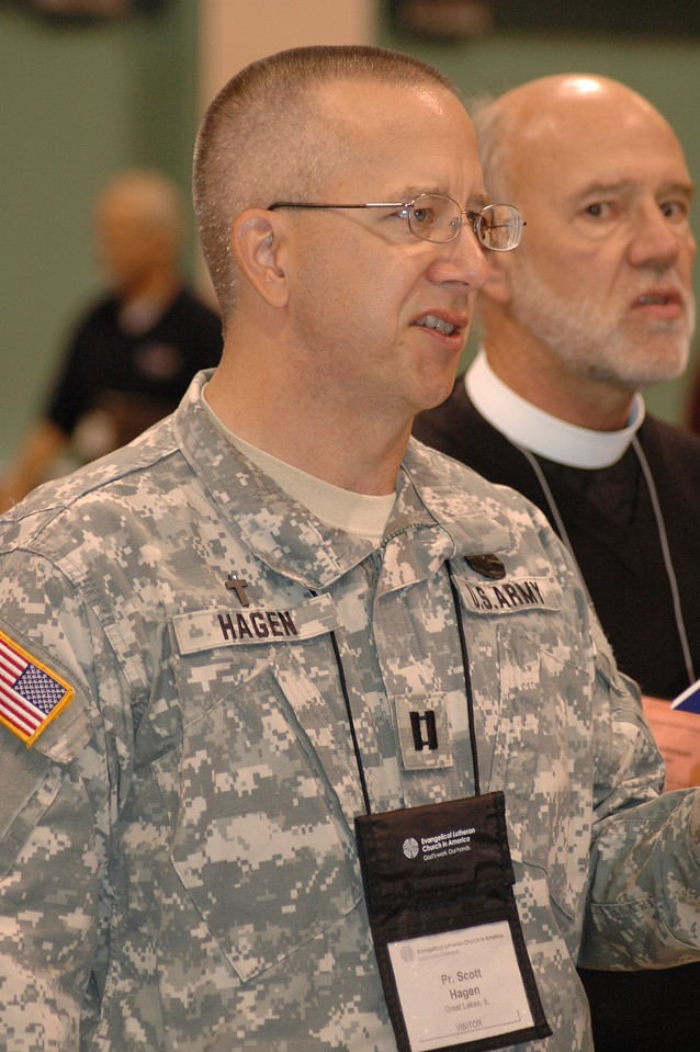 """Pr. Scott Hagen, Great Lakes, IL., joins in singing the Navy hymn, """"Eternal Father, Strong to Save."""""""