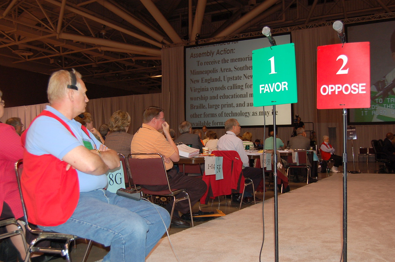 Assembly participants concentrating on the work of the church.