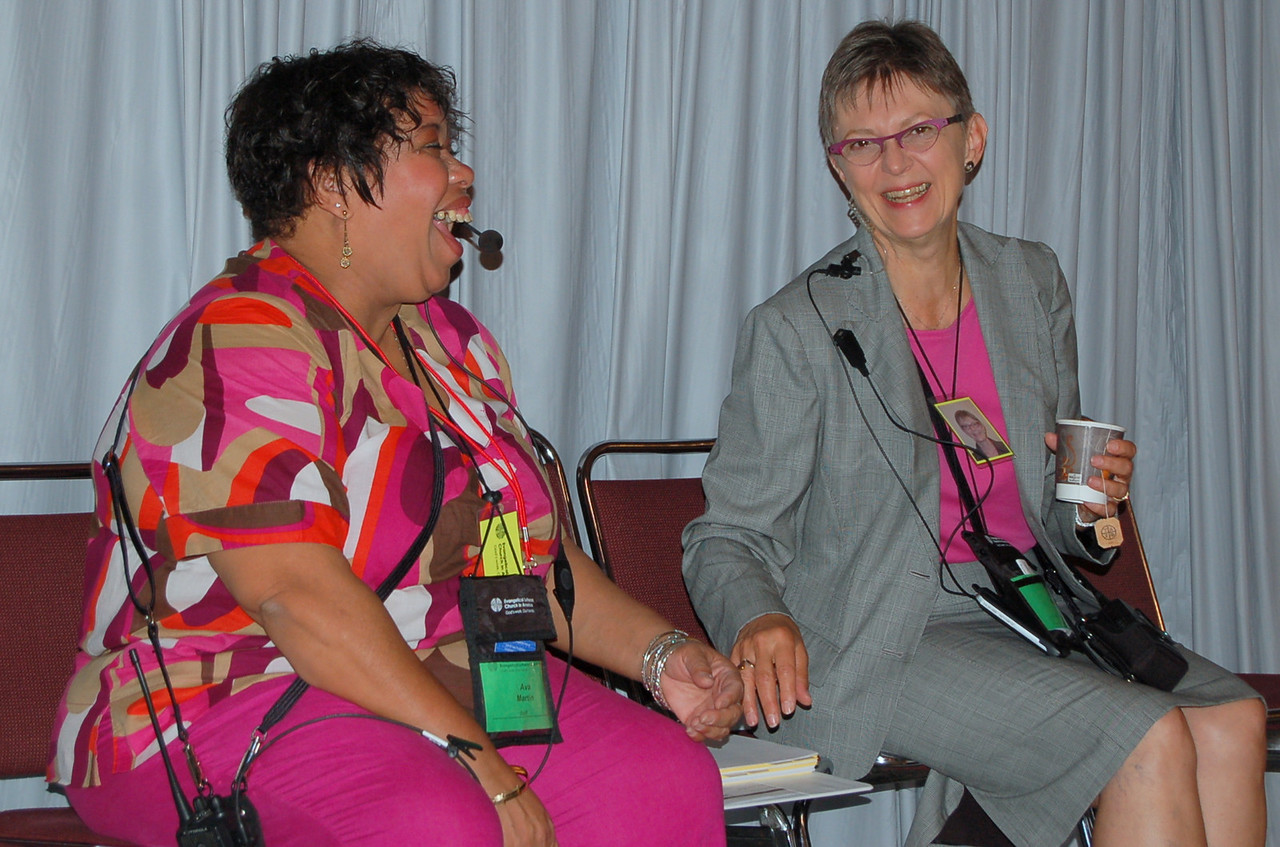 Ava Odom Martin and Kristi Bangert from Communication Services share a moment of laughter.