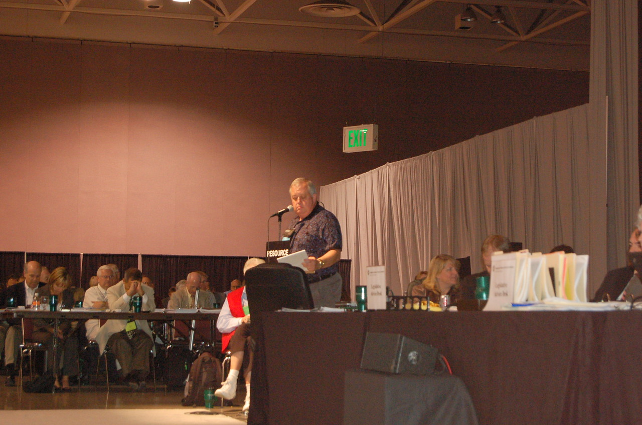 Church council member leads assembly in prayer.