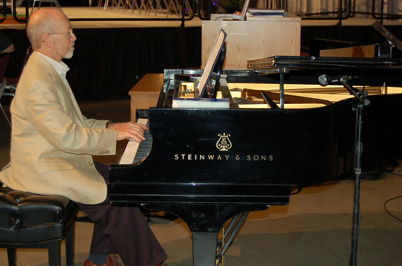 Pianist helps lead the assembly during the bible study.