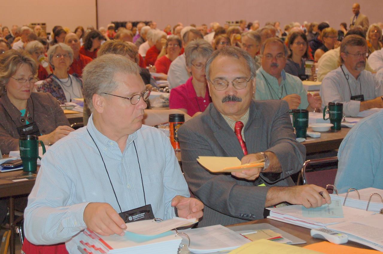 Marshall Hahn passes the nominating ballots.
