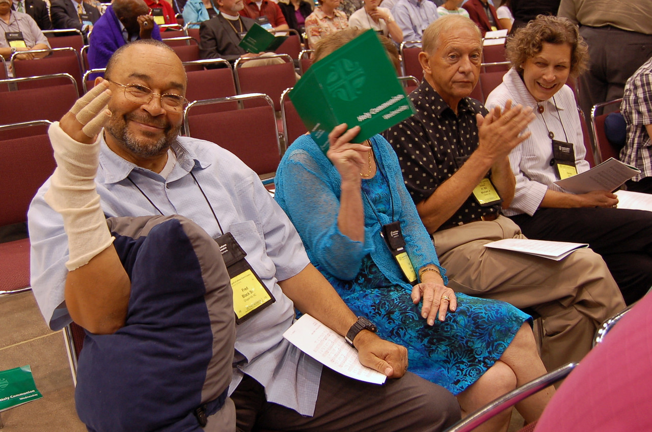Voting member, Fred Black, Sr., shows the photographer an injury.  Fellow voting member is camera shy!