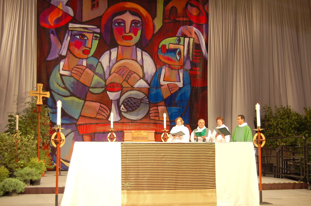 The mural, Supper at Emmaus, is by Chinese artist He Qi. This is the cover art to the Holy Communion section of Evangelical Lutheran Worship.