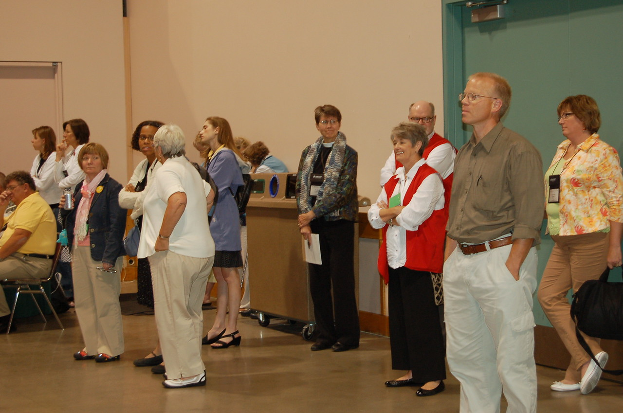 Assembly visitors wait inside during the tornado warning issued during plenary session five.