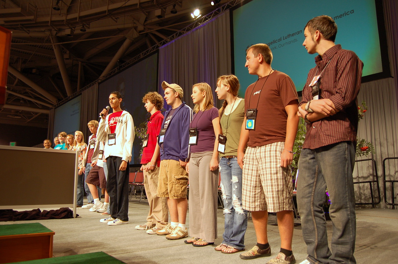 Members from the youth convocation give their report to the assembly.
