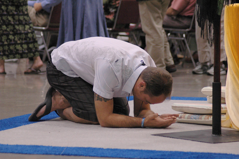 Voting member at prayer