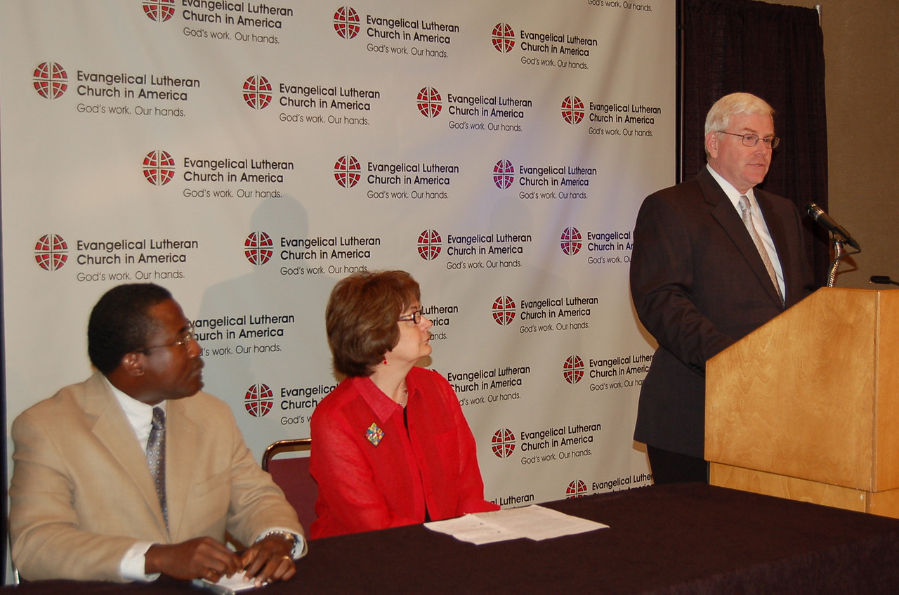 John Brooks, ELCA News Director, begins the news conference by introducing Andrea DeGroot-Nesdahl, coordinator, Lutheran Malaria Initiative, and Louis Dorvilier, director, International Development and Disaster Response, ELCA Global Mission.