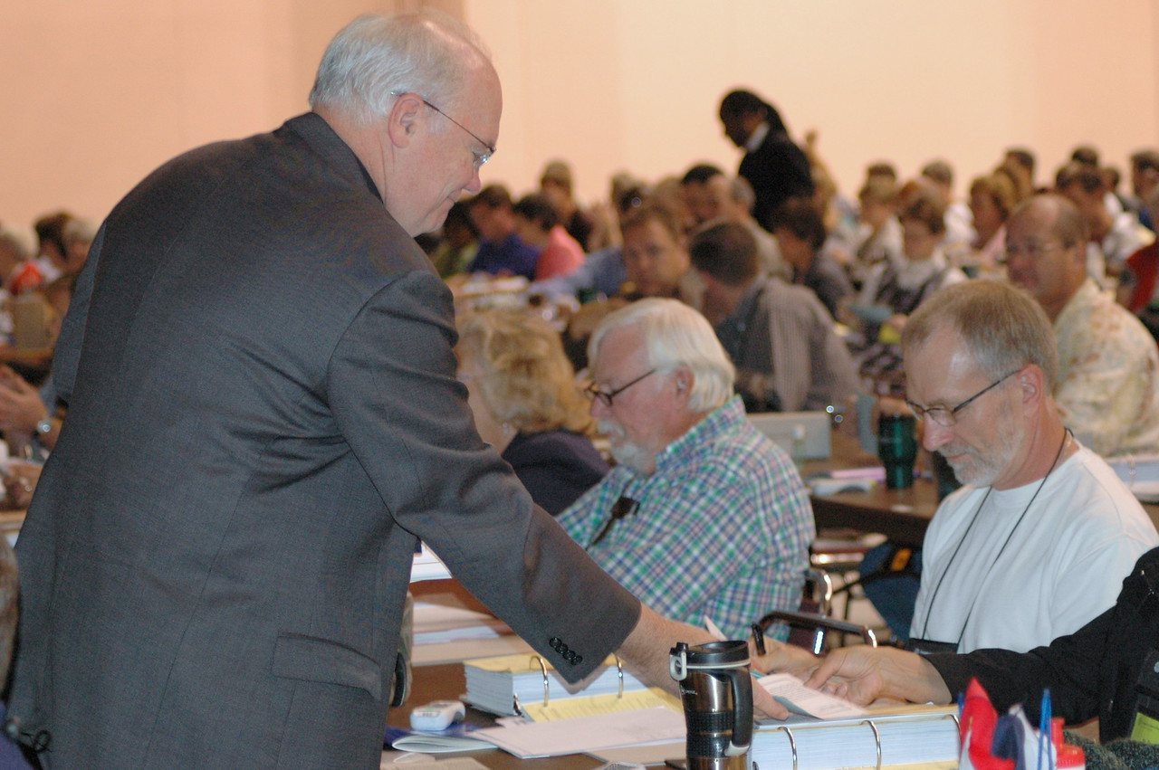 Bp. Craig Johnson distributes the ballots for Vice President to members of his synod.