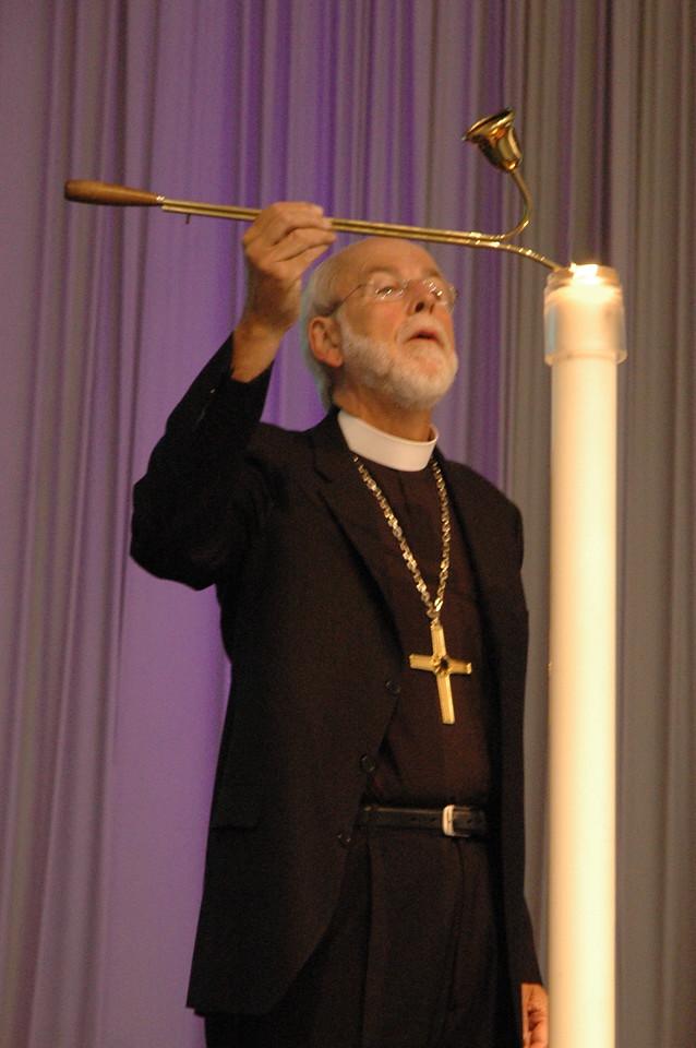 Presiding Bishop Mark Hanson lights the candle as Plenary 4 begins.