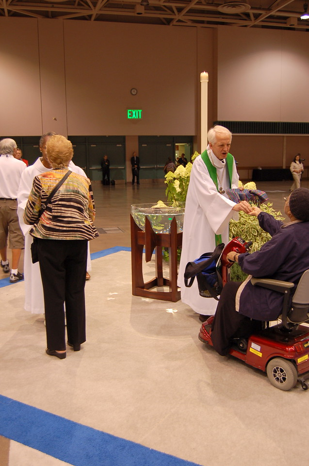 Gluten-free and de-alcoholized wine is available at the station nearest the baptismal font.