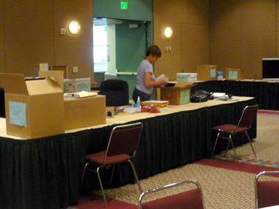 "Connie Sletto, Editorial Specialist/Project Coordinator, prepares the ""Green Room"" where communication staff will gather."