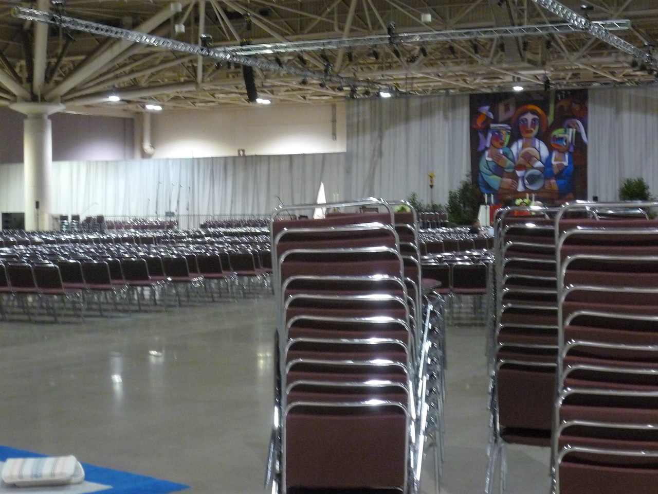 Setting up over a thousand chairs in the worship hall.