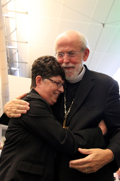 Presiding Bishop Mark Hanson congratulates the Rev. Elizabeth A. Eaton.