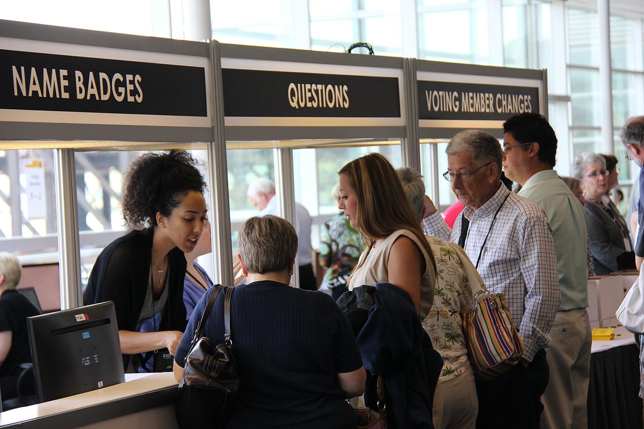 Natalie Young helps register voting members.