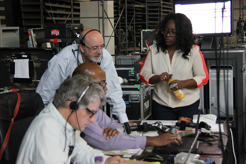 Brett Nelson, Ronney Hunter, Forrest Meyer and Emerald Jane Hunter work behind the stage at the assembly.