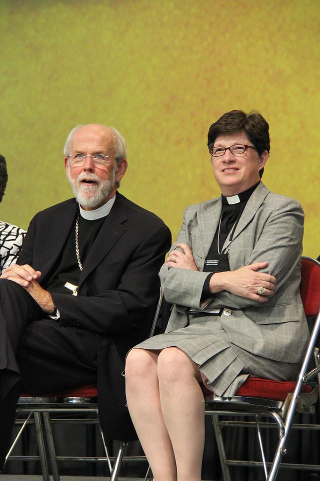 Presiding Bishop Mark Hanson and the Rev. Elizabeth A. Eaton, bishop-elect, listen as the Rev. Wm. Chris Boerger, secretary-elect, speaks.