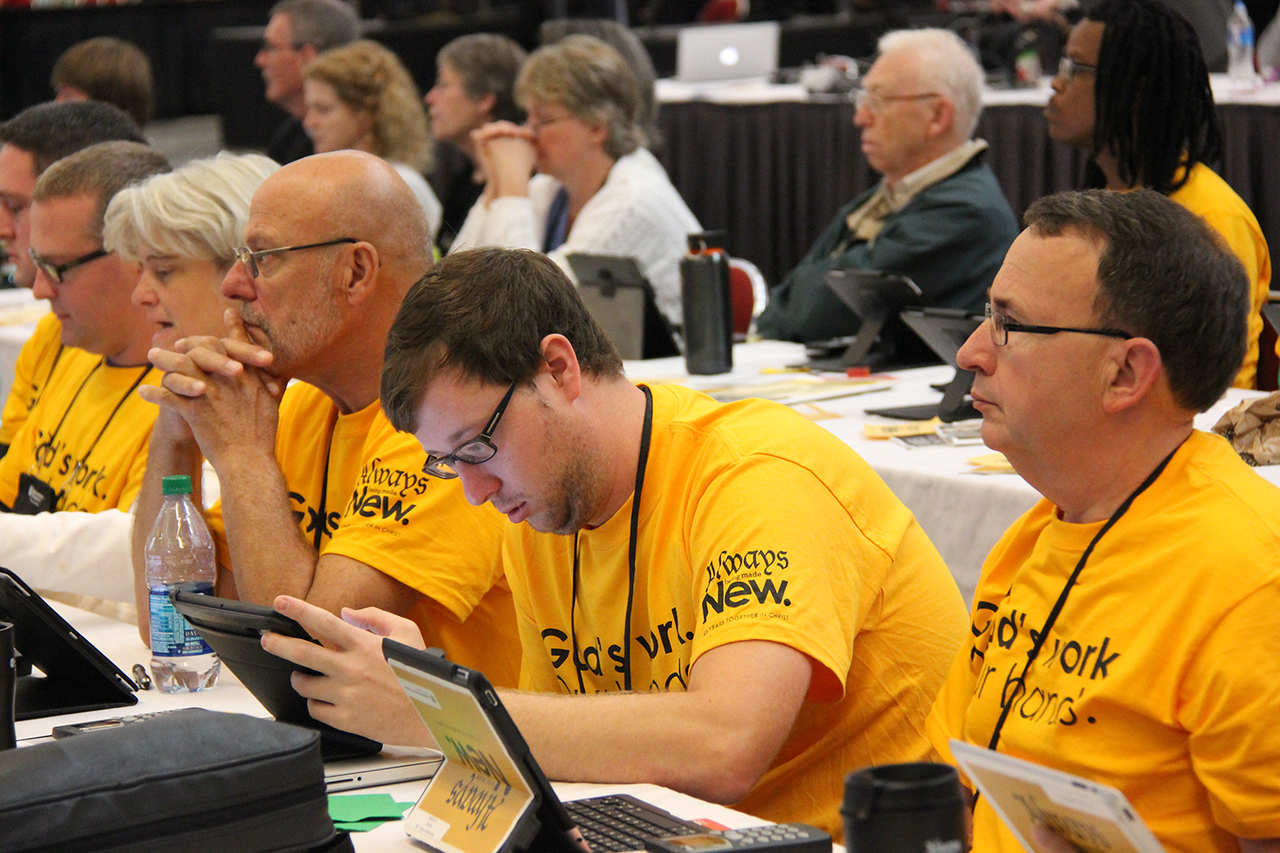 "Members from the ELCA Northwestern Ohio Synod wear  ""God's work. Our hands."" Sunday t-shirts."