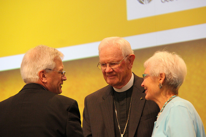 The Rev. Herbert Chilstrom, first/former presiding bishop of the ELCA, and his wife the Rev. E. Corine Chilstrom speak with David Swartling, secretary of the ELCA.