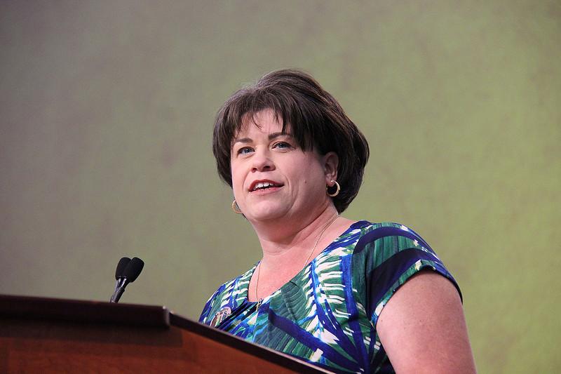 The president of the Women of the ELCA, Jennifer Michael, brings greetings.