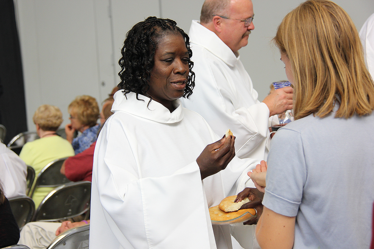 Assembly attendees participate in communion.
