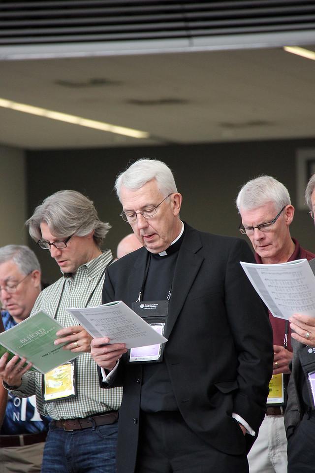 The Rev. Lowell Almen, former secretary of the ELCA, participates in worship.