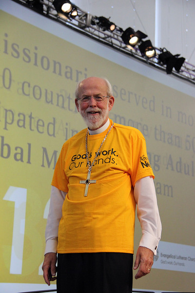"""Presiding Bishop Mark Hanson wears his  """"God's work. Our hands."""" Sunday t-shirt."""