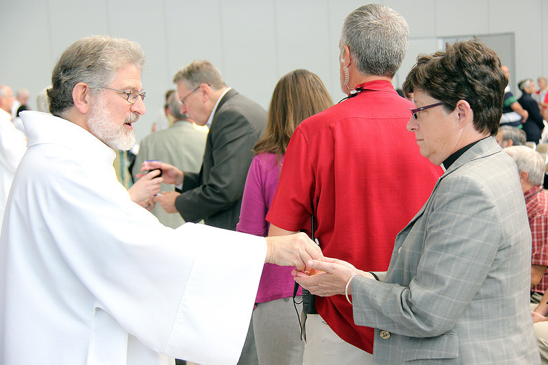 The Rev. Elizabeth A. Eaton, bishop-elect, receives communion.