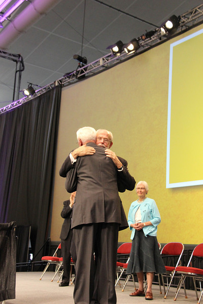 The Rev. Herbert Chilstrom, first/former presiding bishop of the ELCA, hugs Presiding Bishop Mark S. Hanson.