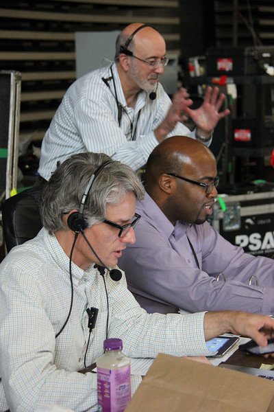 Brett Nelson, Ronney Hunter and Forrest Meyer work behind the stage at the assembly.