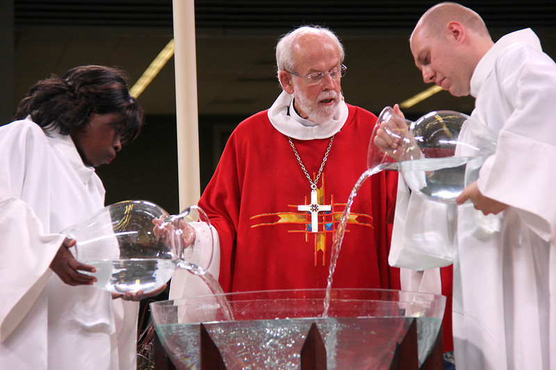 Presiding Bishop Mark S. Hanson leads the thanksgiving for Holy Baptism.