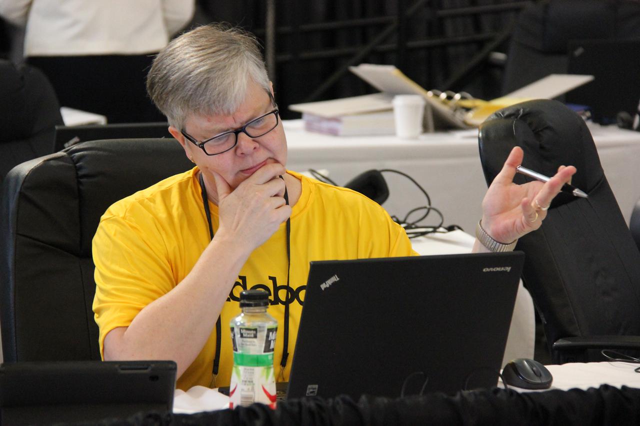 Kristin Koskinen, web developer, checks the online streaming.