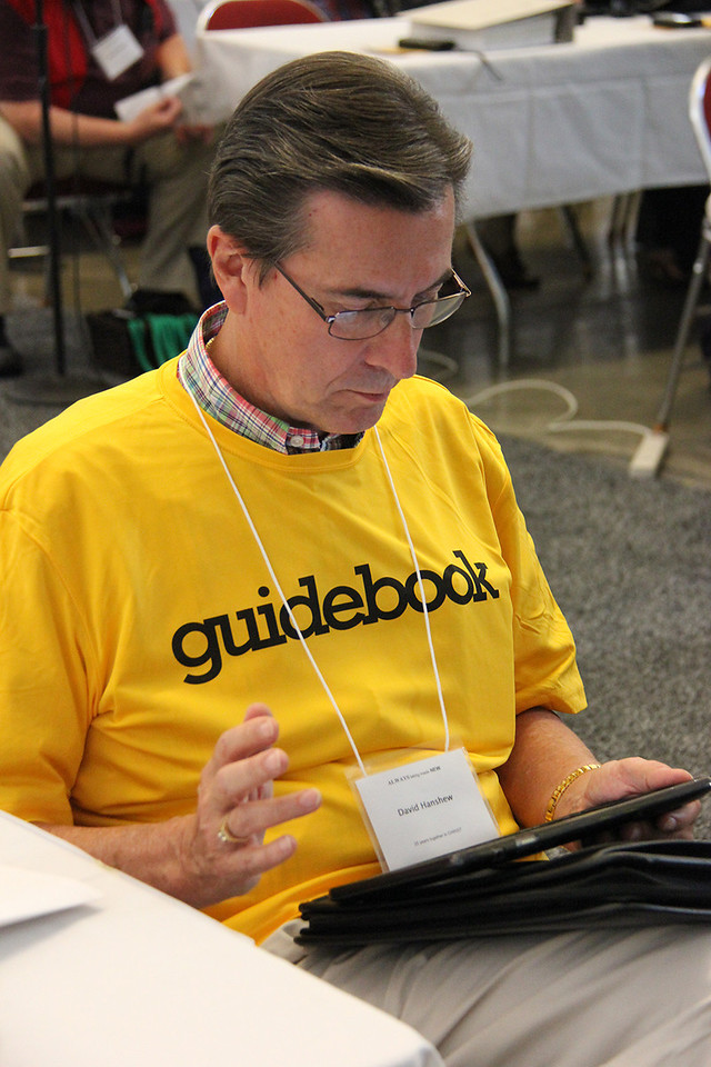 A Guidebook volunteer assists a voting member.