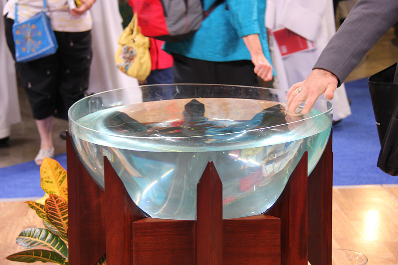 The baptismal font is at the center of worship.