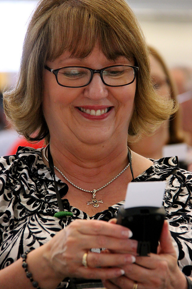 A voting member practices voting during plenary one.