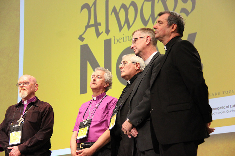The Region 8 bishops are welcomed to the plenary stage.
