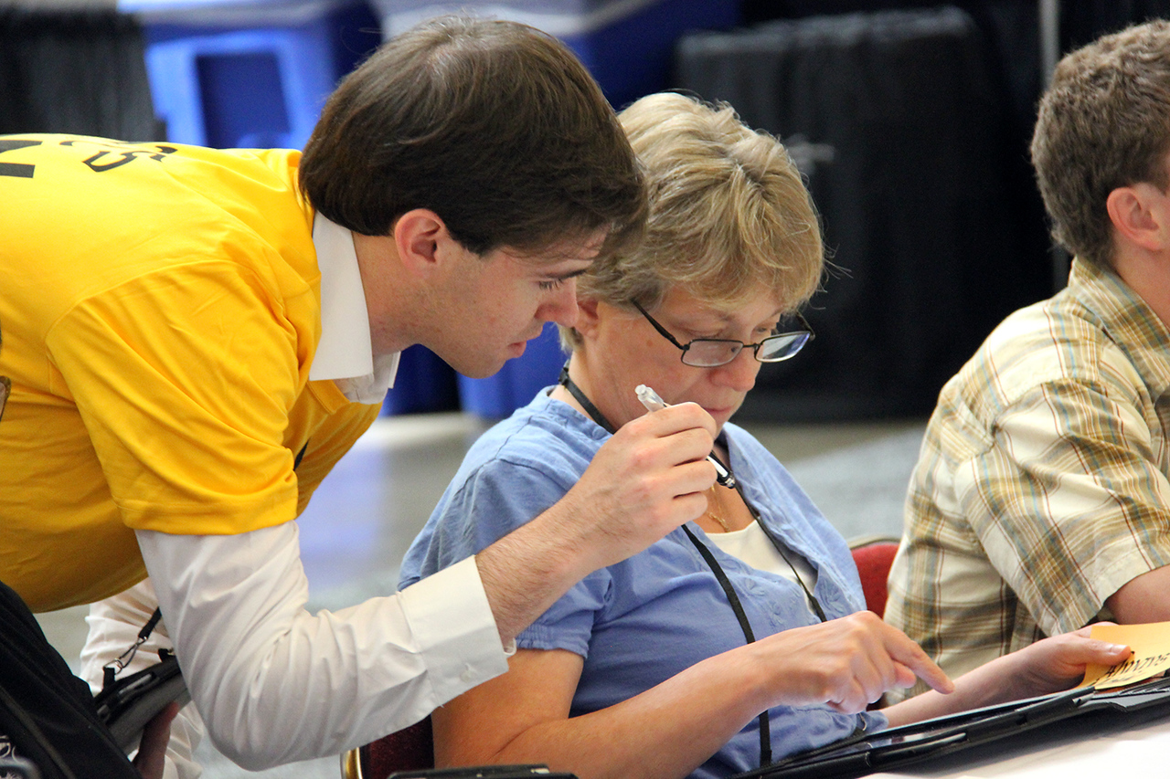 Voting members utilize an electronic Guidebook at the 2013 Assembly.