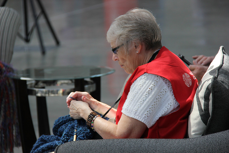 A volunteer relaxes and takes time to knit.