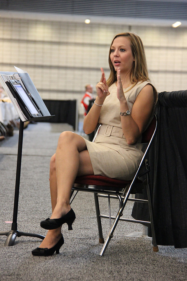 A sign language interpreter signs during the plenary.