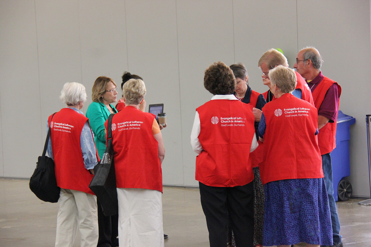Volunteers help at the Assembly.