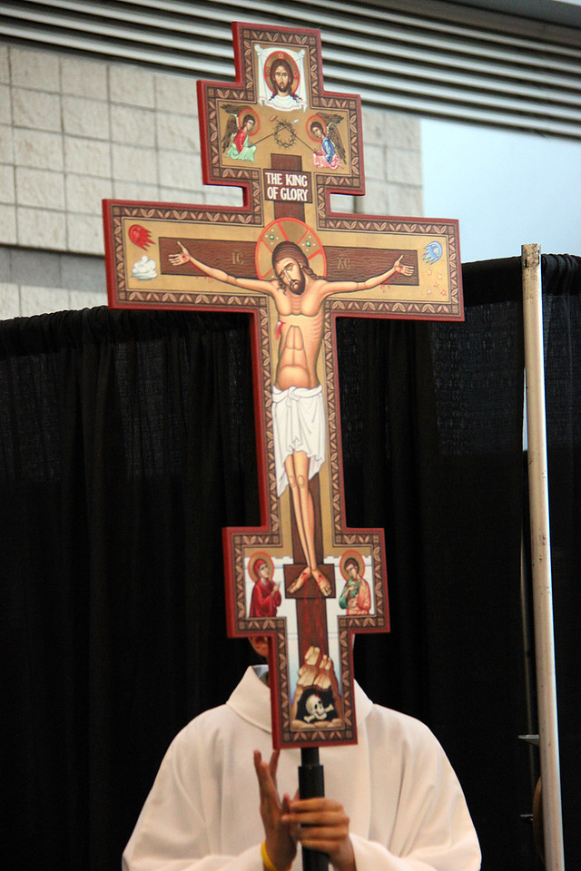 A processional cross is used at the beginning of worship.