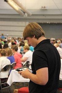 Voting members utilize an electronic Guidebook during the plenary.