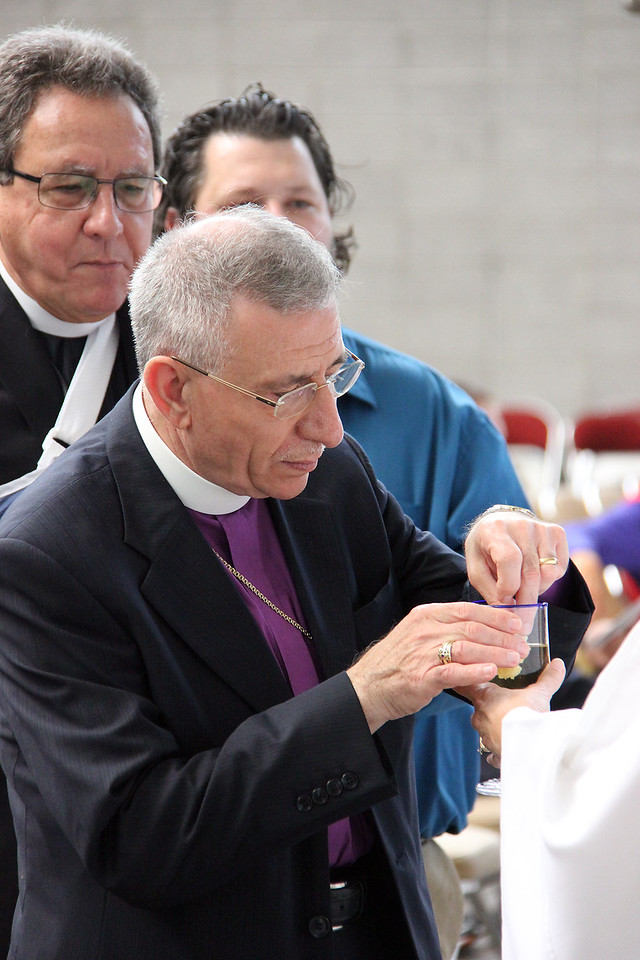 Bishop Munib Younan shares in Holy Communion.