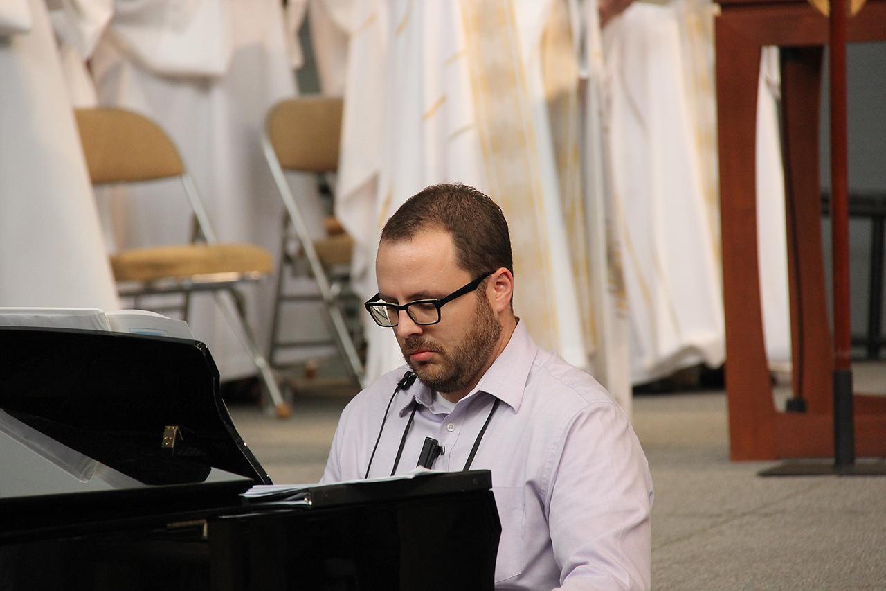A musician accompanies worship.