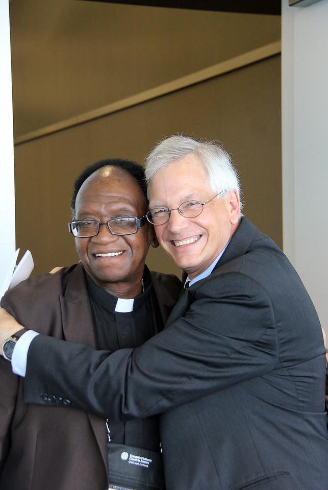 David Swartling, secretary of the ELCA, hugs the Rev. Walter May.