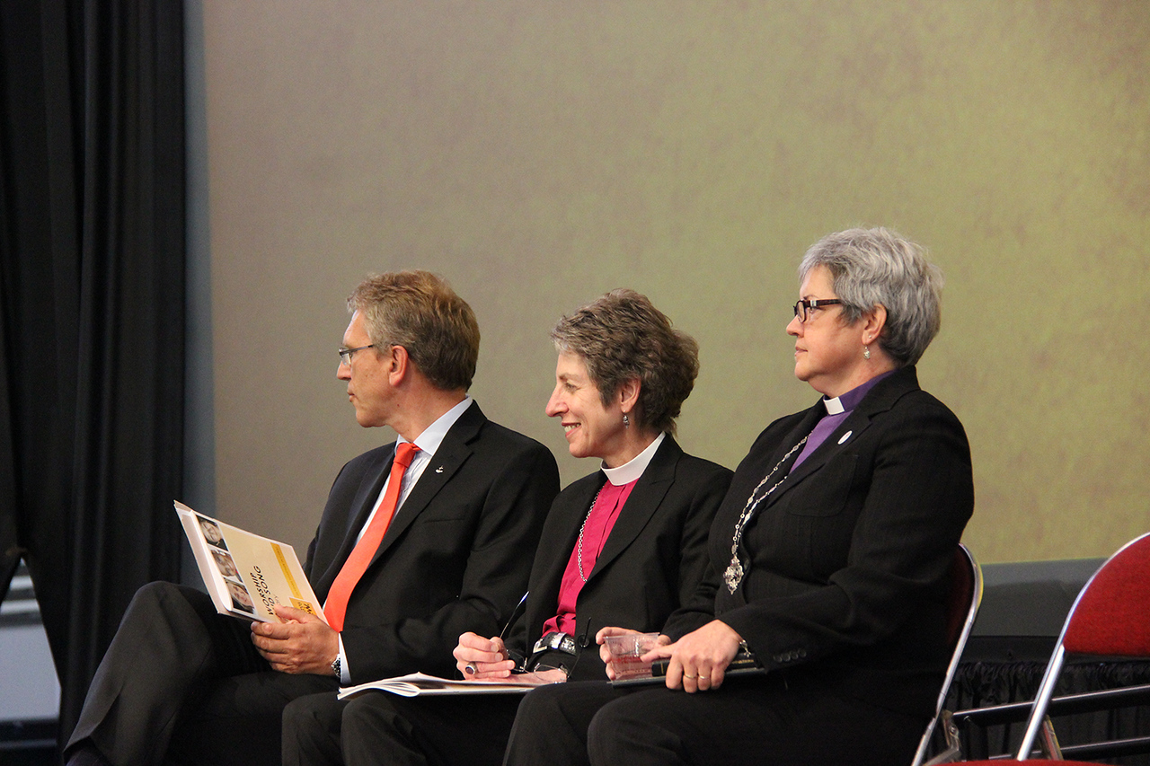 The Rev. Dr. Olav Fykse Tveit, general secretary of the World Council of Churches, the Most Reverend Katharine Jefferts Schori, presiding bishop of The Episcopal Church and Bishop Susan Johnson, the national bishop of the Evangelical Lutheran Church in Canada and the Lutheran World Federation Vice-President for North America, wait to greet the Assembly.
