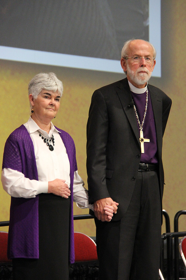 Presiding Bishop Mark S. Hanson receives the Servus Dei Medal. This medal honors officers of the Evangelical Lutheran Church in America at the completion of their terms and continues a tradition that was begun in our predecessor church bodies. Mrs. Ione Hanson stands by his side.